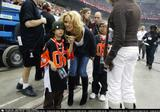 Pamela Anderson takes her son to the Grey Cup game